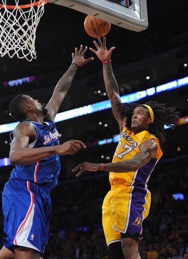 Oct 29, 2013; Los Angeles, CA, USA;   Los Angeles Clippers center DeAndre Jordan (6) guards Los Angeles Lakers center Jordan Hill (27) in the second half of the game at the Staples Center. Lakers won 116-103. Mandatory Credit: Jayne Kamin-Oncea-USA TODAY Sports