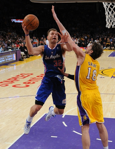 Oct 29, 2013; Los Angeles, CA, USA;   Los Angeles Lakers power forward Pau Gasol (16) guards Los Angeles Clippers power forward Blake Griffin (32) during the game at the Staples Center. Lakers won 116-103. Mandatory Credit: Jayne Kamin-Oncea-USA TODAY Sports