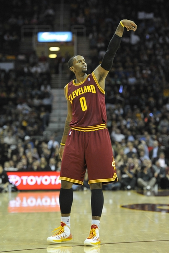 Oct 30, 2013; Cleveland, OH, USA; Cleveland Cavaliers shooting guard C.J. Miles (0) follows through on a three-point basket in the first quarter against the Brooklyn Nets at Quicken Loans Arena. Mandatory Credit: David Richard-USA TODAY Sports