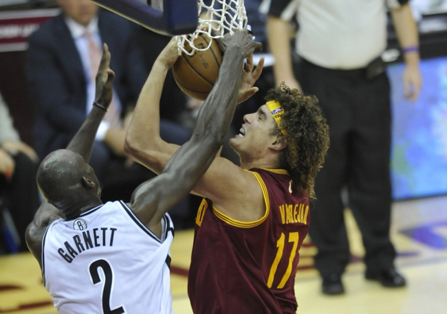 Oct 30, 2013; Cleveland, OH, USA; Brooklyn Nets power forward Kevin Garnett (2) defends a shot by Cleveland Cavaliers center Anderson Varejao (17) in the second quarter at Quicken Loans Arena. Mandatory Credit: David Richard-USA TODAY Sports