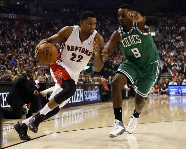 Oct 30, 2013; Toronto, Ontario, CAN; Toronto Raptors forward Rudy Gay (22) drives to the net against Boston Celtics forward Jeff Green (8) during the first half at the Air Canada Centre. Mandatory Credit: John E. Sokolowski-USA TODAY Sports