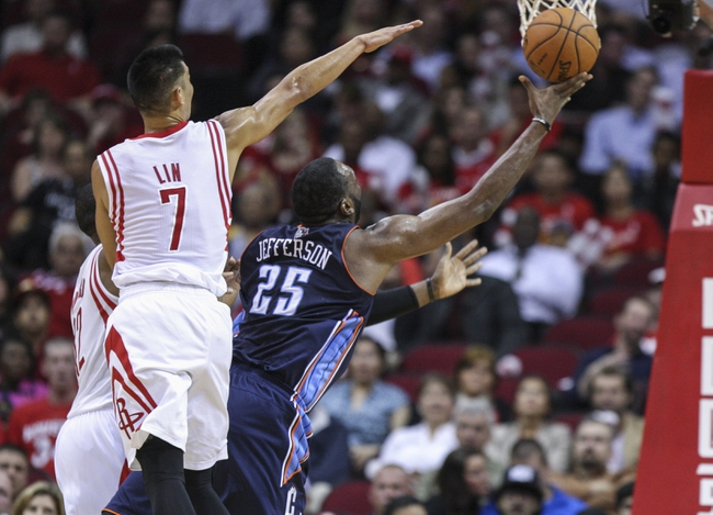 Oct 30, 2013; Houston, TX, USA; Charlotte Bobcats center Al Jefferson (25) shoots the ball during the second quarter as Houston Rockets point guard Jeremy Lin (7) defends at Toyota Center. Mandatory Credit: Troy Taormina-USA TODAY Sports