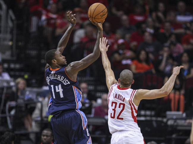 Oct 30, 2013; Houston, TX, USA; Charlotte Bobcats small forward Michael Kidd-Gilchrist (14) shoots during the second quarter as Houston Rockets shooting guard Francisco Garcia (32) defends at Toyota Center. Mandatory Credit: Troy Taormina-USA TODAY Sports