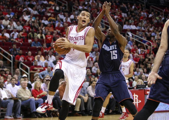 Oct 30, 2013; Houston, TX, USA; Houston Rockets point guard Jeremy Lin (7) drives to the basket during the second quarter as Charlotte Bobcats point guard Kemba Walker (15) defends at Toyota Center. Mandatory Credit: Troy Taormina-USA TODAY Sports