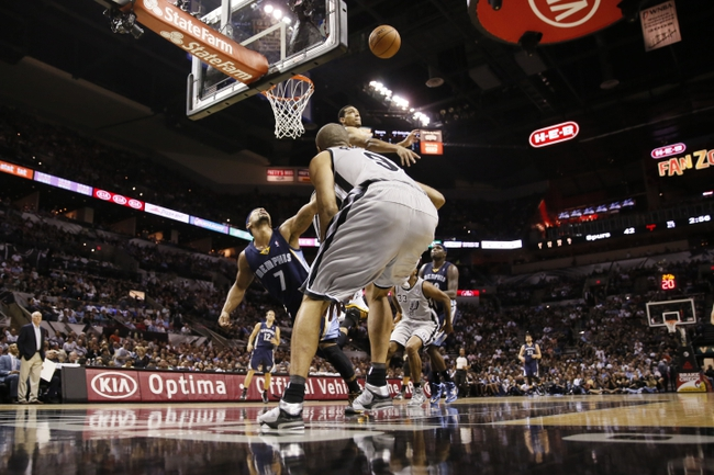 Oct 30, 2013; San Antonio, TX, USA; Memphis Grizzlies guard Jerryd Bayless (7) has his shot blocked by San Antonio Spurs guard Danny Green (top) during the first half at AT&T Center. Mandatory Credit: Soobum Im-USA TODAY Sports