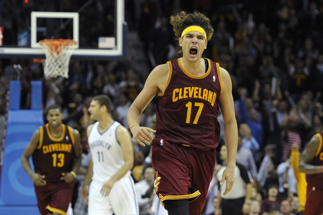 Oct 30, 2013; Cleveland, OH, USA; Cleveland Cavaliers center Anderson Varejao (17) celebrates after a basket in the fourth quarter against the Brooklyn Nets at Quicken Loans Arena. Mandatory Credit: David Richard-USA TODAY Sports