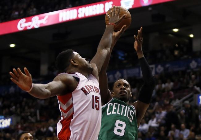 Oct 30, 2013; Toronto, Ontario, CAN; Toronto Raptors forward-center Amir Johnson (15) defends against Boston Celtics forward Jeff Green (8) at the Air Canada Centre. Toronto defeated Boston 93-87. Mandatory Credit: John E. Sokolowski-USA TODAY Sports