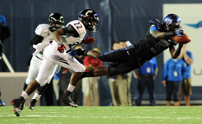 Oct 30, 2013; Memphis, TN, USA; Memphis Tigers wide receiver Mose Frazier (5) catches a pass thrown by Memphis Tigers quarterback Paxton Lynch (12) not pictured during the second quarter at Liberty Bowl Memorial. Mandatory Credit: Justin Ford-USA TODAY Sports