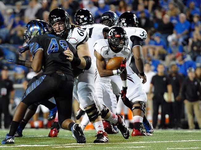 Oct 30, 2013; Memphis, TN, USA; Cincinnati Bearcats running back Ralph Abernathy (1) carries the ball against Memphis Tigers during the second quarter at Liberty Bowl Memorial. Mandatory Credit: Justin Ford-USA TODAY Sports