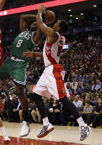 Oct 30, 2013; Toronto, Ontario, CAN; Toronto Raptors guard DeMar DeRozan (10) knocks the ball away from Boston Celtics forward Jeff Green (8) at the Air Canada Centre. Toronto defeated Boston 93-87. Mandatory Credit: John E. Sokolowski-USA TODAY Sports