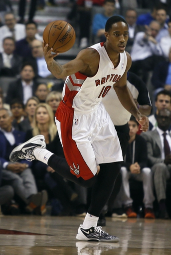 Oct 30, 2013; Toronto, Ontario, CAN; Toronto Raptors guard DeMar DeRozan (10) dribbles the ball against the Boston Celtics at the Air Canada Centre. Toronto defeated Boston 93-87. Mandatory Credit: John E. Sokolowski-USA TODAY Sports