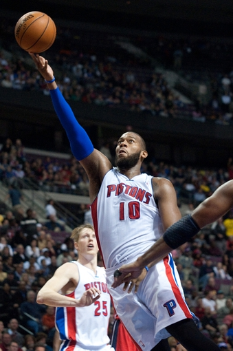 Oct 30, 2013; Auburn Hills, MI, USA; Detroit Pistons center Greg Monroe (10) goes to the basket during the fourth quarter against the Washington Wizards at The Palace of Auburn Hills. Pistons won 113-102. Mandatory Credit: Tim Fuller-USA TODAY Sports