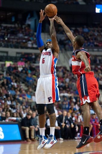 Oct 30, 2013; Auburn Hills, MI, USA; Detroit Pistons small forward Josh Smith (6) shots during the fourth quarter against the Washington Wizards at The Palace of Auburn Hills. Pistons won 113-102. Mandatory Credit: Tim Fuller-USA TODAY Sports