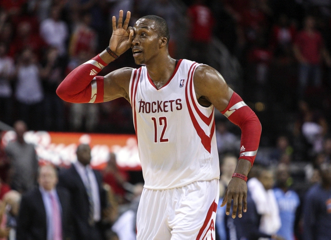 Oct 30, 2013; Houston, TX, USA; Houston Rockets center Dwight Howard (12) reacts after a play during the fourth quarter against the Charlotte Bobcats at Toyota Center. The Rockets defeated the Bobcats 96-83. Mandatory Credit: Troy Taormina-USA TODAY Sports