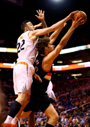 Oct 30, 2013; Phoenix, AZ, USA; Phoenix Suns center Miles Plumlee (22) blocks the shot of Portland Trail Blazers center Robin Lopez in the first quarter at US Airways Center. Mandatory Credit: Mark J. Rebilas-USA TODAY Sports