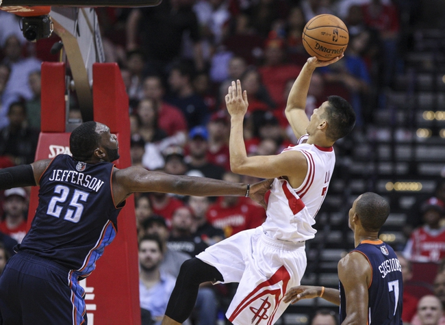 Oct 30, 2013; Houston, TX, USA; Houston Rockets point guard Jeremy Lin (7) shoots during the fourth quarter as Charlotte Bobcats center Al Jefferson (25) defends at Toyota Center. The Rockets defeated the Bobcats 96-83. Mandatory Credit: Troy Taormina-USA TODAY Sports