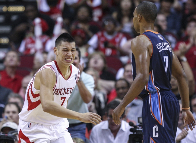 Oct 30, 2013; Houston, TX, USA; Houston Rockets point guard Jeremy Lin (7) reacts after a play during the fourth quarter against the Charlotte Bobcats at Toyota Center. The Rockets defeated the Bobcats 96-83. Mandatory Credit: Troy Taormina-USA TODAY Sports