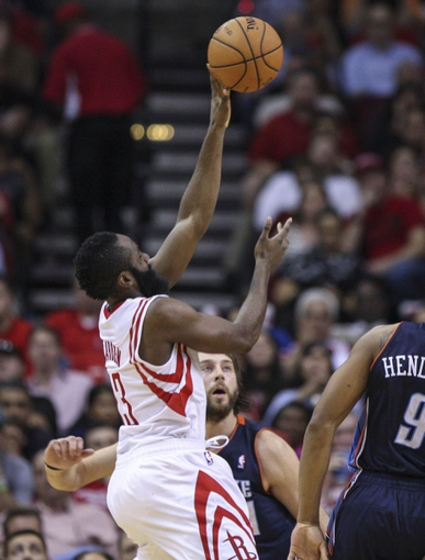 Oct 30, 2013; Houston, TX, USA; Houston Rockets shooting guard James Harden (13) shoots during the fourth quarter against the Charlotte Bobcats at Toyota Center. The Rockets defeated the Bobcats 96-83. Mandatory Credit: Troy Taormina-USA TODAY Sports