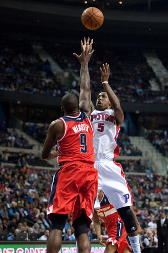 Oct 30, 2013; Auburn Hills, MI, USA; Detroit Pistons shooting guard Kentavious Caldwell-Pope (5) shoots over Washington Wizards small forward Martell Webster (9) during the fourth quarter at The Palace of Auburn Hills. Pistons won 113-102. Mandatory Credit: Tim Fuller-USA TODAY Sports