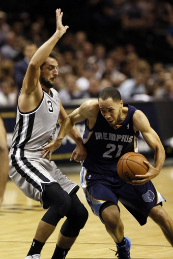 Oct 30, 2013; San Antonio, TX, USA; Memphis Grizzlies forward Tayshaun Prince (21) drives to the basket as San Antonio Spurs forward Marco Belinelli (3) defends during the first half at AT&T Center. Mandatory Credit: Soobum Im-USA TODAY Sports