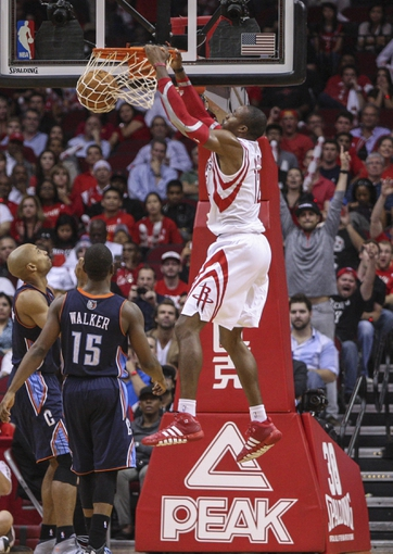 Oct 30, 2013; Houston, TX, USA; Houston Rockets center Dwight Howard (12) dunks the ball during the fourth quarter against the Charlotte Bobcats at Toyota Center. The Rockets defeated the Bobcats 96-83. Mandatory Credit: Troy Taormina-USA TODAY Sports