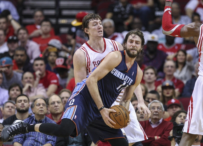 Oct 30, 2013; Houston, TX, USA; Charlotte Bobcats power forward Josh McRoberts (11) gets a rebound during the third quarter as Houston Rockets center Omer Asik (3) defends at Toyota Center. The Rockets defeated the Bobcats 96-83. Mandatory Credit: Troy Taormina-USA TODAY Sports