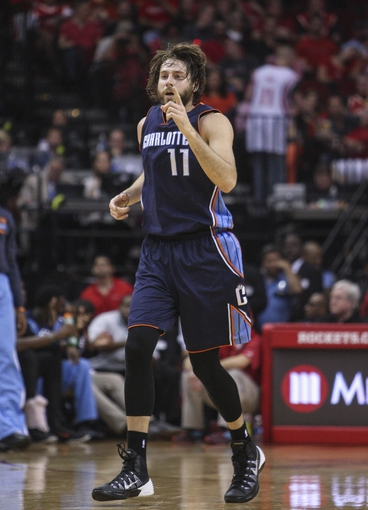 Oct 30, 2013; Houston, TX, USA; Charlotte Bobcats power forward Josh McRoberts (11) reacts after making a basket during the third quarter against the Houston Rockets at Toyota Center. Mandatory Credit: Troy Taormina-USA TODAY Sports