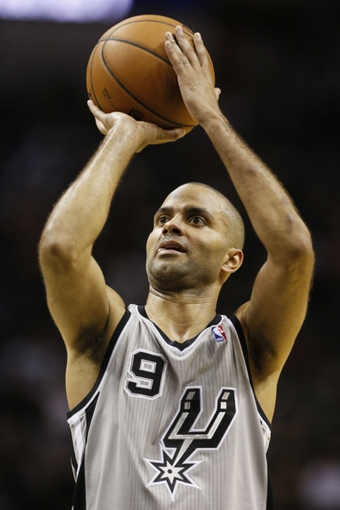 Oct 30, 2013; San Antonio, TX, USA; San Antonio Spurs guard Tony Parker (9) shoots a free throw during the second half against the Memphis Grizzlies at AT&T Center. The Spurs won 101-94. Mandatory Credit: Soobum Im-USA TODAY Sports