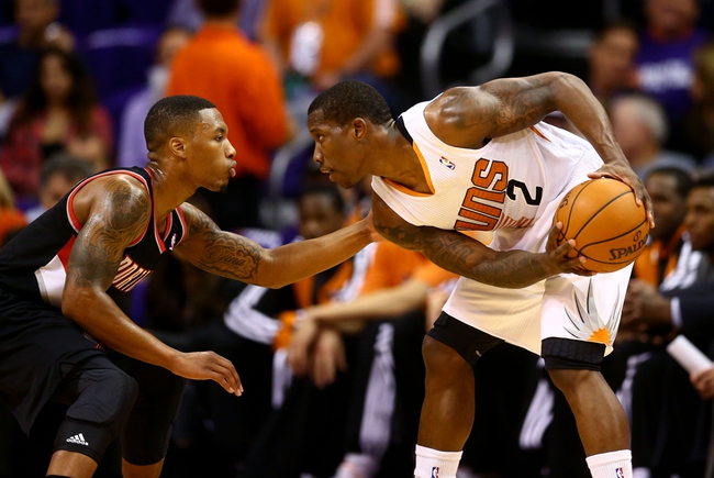 Oct 30, 2013; Phoenix, AZ, USA; Phoenix Suns guard Eric Bledsoe (right) controls the ball against Portland Trail Blazers guard Damian Lillard in the first half at US Airways Center. Mandatory Credit: Mark J. Rebilas-USA TODAY Sports