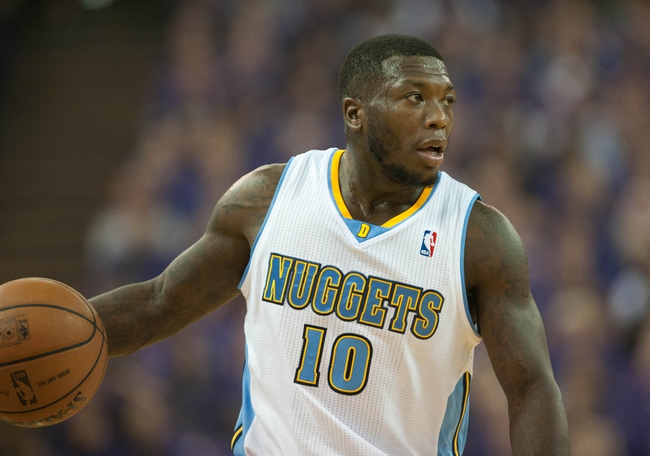 Oct 30, 2013; Sacramento, CA, USA; Denver Nuggets point guard Nate Robinson (10) brings the ball up the court during the second quarter of the game against the Sacramento Kings at Sleep Train Arena. Mandatory Credit: Ed Szczepanski-USA TODAY Sports