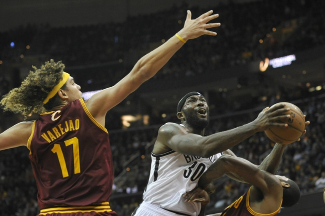 Oct 30, 2013; Cleveland, OH, USA; Brooklyn Nets power forward Reggie Evans (30) drives between Cleveland Cavaliers center Anderson Varejao (17) and small forward Earl Clark (6) in the fourth quarter at Quicken Loans Arena. Mandatory Credit: David Richard-USA TODAY Sports