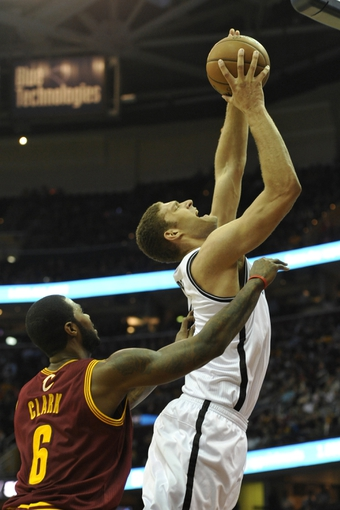 Oct 30, 2013; Cleveland, OH, USA; Brooklyn Nets center Brook Lopez (11) shoots beside Cleveland Cavaliers small forward Earl Clark (6) in the third quarter at Quicken Loans Arena. Mandatory Credit: David Richard-USA TODAY Sports