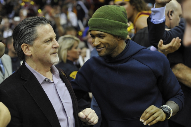 Oct 30, 2013; Cleveland, OH, USA; Music entertainer Usher (right) and Cleveland Cavaliers owner Dan Gilbert react after watching the Cavaliers defeat the Brooklyn Nets 98-94 at Quicken Loans Arena. Mandatory Credit: David Richard-USA TODAY Sports