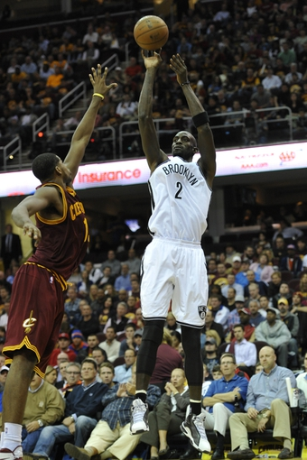Oct 30, 2013; Cleveland, OH, USA; Brooklyn Nets power forward Kevin Garnett (2) shoots over Cleveland Cavaliers power forward Tristan Thompson (13) in the fourth quarter at Quicken Loans Arena. Mandatory Credit: David Richard-USA TODAY Sports