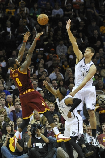 Oct 30, 2013; Cleveland, OH, USA; Cleveland Cavaliers small forward Earl Clark (6) attempts a shot over Brooklyn Nets small forward Paul Pierce (34) and center Brook Lopez (11) in the fourth quarter at Quicken Loans Arena. Mandatory Credit: David Richard-USA TODAY Sports