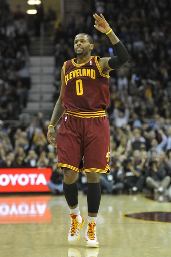 Oct 30, 2013; Cleveland, OH, USA; Cleveland Cavaliers shooting guard C.J. Miles (0) celebrates a three-point goal in the first quarter against the Brooklyn Nets at Quicken Loans Arena. Mandatory Credit: David Richard-USA TODAY Sports