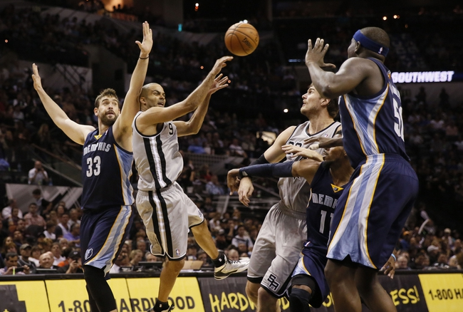 Oct 30, 2013; San Antonio, TX, USA; San Antonio Spurs guard Tony Parker (9) passes the ball against Memphis Grizzlies center Marc Gasol (33) during the second half at AT&T Center. The Spurs won 101-94. Mandatory Credit: Soobum Im-USA TODAY Sports