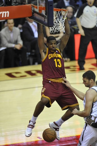 Oct 30, 2013; Cleveland, OH, USA; Cleveland Cavaliers power forward Tristan Thompson (13) dunks against the Brooklyn Nets in the second quarter at Quicken Loans Arena. Mandatory Credit: David Richard-USA TODAY Sports