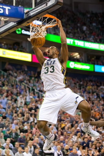 Oct 30, 2013; Salt Lake City, UT, USA; Utah Jazz small forward Mike Harris (33) dunks during the second half against the Oklahoma City Thunder at EnergySolutions Arena. Oklahoma City won 101-98. Mandatory Credit: Russ Isabella-USA TODAY Sports