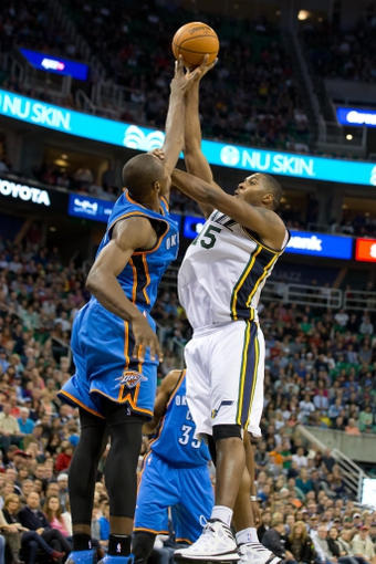 Oct 30, 2013; Salt Lake City, UT, USA; Utah Jazz power forward Derrick Favors (15) attempts to shoot over Oklahoma City Thunder power forward Serge Ibaka (9) during the second half at EnergySolutions Arena. Oklahoma City won 101-98. Mandatory Credit: Russ Isabella-USA TODAY Sports