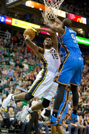 Oct 30, 2013; Salt Lake City, UT, USA; Utah Jazz power forward Derrick Favors (15) goes up for a shot while defended by Oklahoma City Thunder power forward Serge Ibaka (9) during the second half at EnergySolutions Arena. Oklahoma City won 101-98. Mandatory Credit: Russ Isabella-USA TODAY Sports