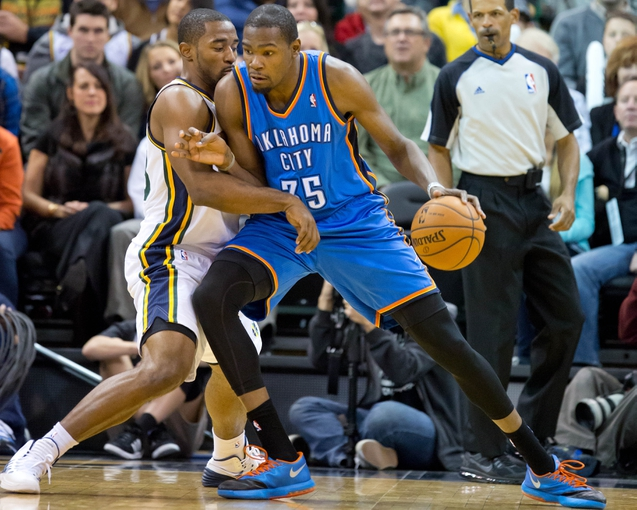 Oct 30, 2013; Salt Lake City, UT, USA; Oklahoma City Thunder small forward Kevin Durant (35) is defended by Utah Jazz small forward Mike Harris (33) during the second half at EnergySolutions Arena. Oklahoma City won 101-98. Mandatory Credit: Russ Isabella-USA TODAY Sports