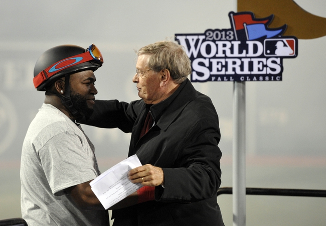 Oct 30, 2013; Boston, MA, USA; Boston Red Sox designated hitter David Ortiz (left) hugs MLB commissioner Bud Selig after game six of the MLB baseball World Series against the St. Louis Cardinals at Fenway Park. The Red Sox won 6-1 to win the series four games to two. Mandatory Credit: Robert Deutsch-USA TODAY Sports