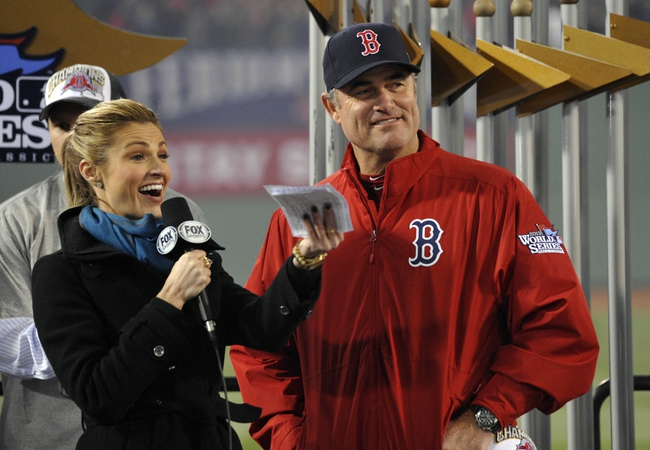 Oct 30, 2013; Boston, MA, USA; Boston Red Sox manager John Farrell (right) is interviewed by FOX reporter Erin Andrews after game six of the MLB baseball World Series against the St. Louis Cardinals at Fenway Park. The Red Sox won 6-1 to win the series four games to two. Mandatory Credit: Robert Deutsch-USA TODAY Sports