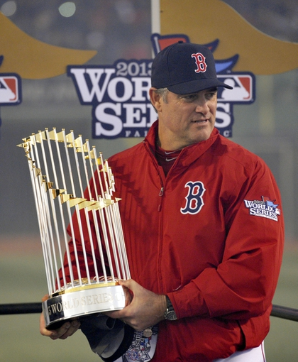 Oct 30, 2013; Boston, MA, USA; Boston Red Sox manager John Farrell holds the World Series championship trophy after game six of the MLB baseball World Series against the St. Louis Cardinals at Fenway Park. The Red Sox won 6-1 to win the series four games to two. Mandatory Credit: Robert Deutsch-USA TODAY Sports