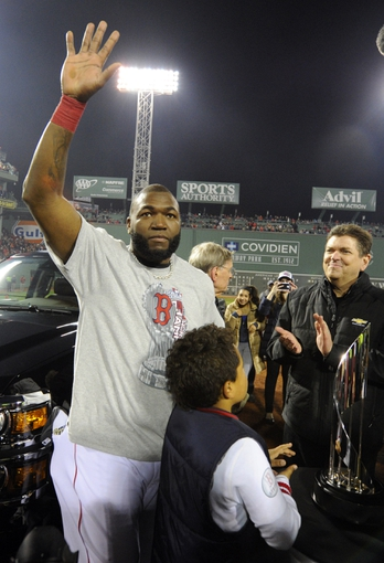 Oct 30, 2013; Boston, MA, USA; Boston Red Sox designated hitter David Ortiz waves to the crowd after being named series MVP after game six of the MLB baseball World Series against the St. Louis Cardinals at Fenway Park. The Red Sox won 6-1 to win the series four games to two. Mandatory Credit: Robert Deutsch-USA TODAY Sports