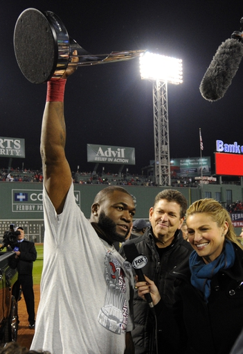 Oct 30, 2013; Boston, MA, USA; Boston Red Sox designated hitter David Ortiz (left) hoists the series MVP trophy while being interviewed by FOX reporter Erin Andrews after game six of the MLB baseball World Series against the St. Louis Cardinals at Fenway Park. The Red Sox won 6-1 to win the series four games to two. Mandatory Credit: Robert Deutsch-USA TODAY Sports