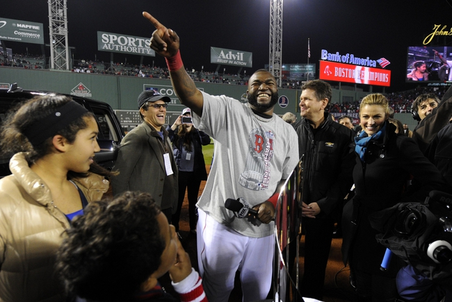 Oct 30, 2013; Boston, MA, USA; Boston Red Sox designated hitter David Ortiz gestures to the crowd after being named World Series MVP after game six of the MLB baseball World Series against the St. Louis Cardinals at Fenway Park. The Red Sox won 6-1 to win the series four games to two. Mandatory Credit: Robert Deutsch-USA TODAY Sports