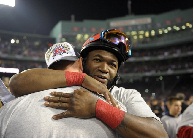 Oct 30, 2013; Boston, MA, USA; Boston Red Sox designated hitter David Ortiz (facing forward) celebrates with teammates on the field after game six of the MLB baseball World Series against the St. Louis Cardinals at Fenway Park. The Red Sox won 6-1 to win the series four games to two. Mandatory Credit: Bob DeChiara-USA TODAY Sports