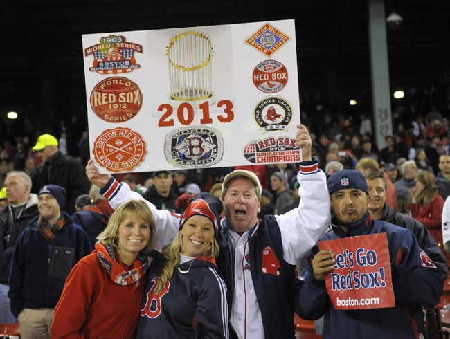 Oct 30, 2013; Boston, MA, USA; Boston Red Sox fans celebrate after game six of the MLB baseball World Series against the St. Louis Cardinals at Fenway Park. The Red Sox won 6-1 to win the series four games to two. Mandatory Credit: Bob DeChiara-USA TODAY Sports